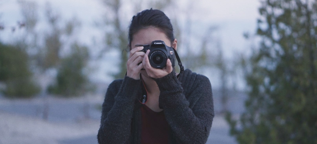 Amanda Lin holding a camera in front of her face.